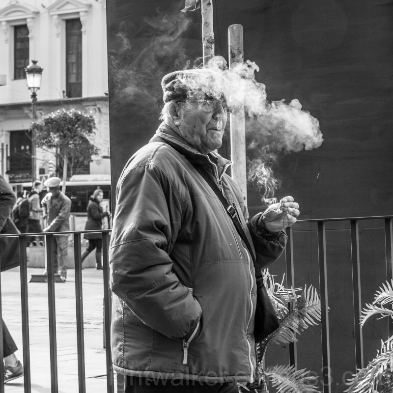 Smoking man at Pl. J. Benavente