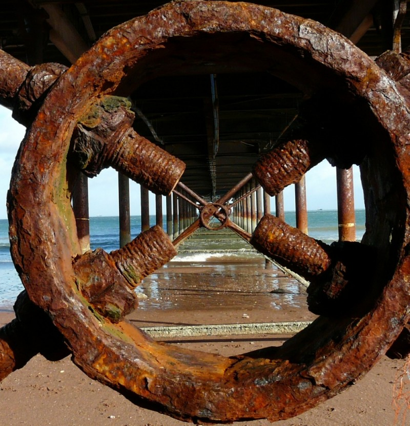 Peering under Paignton Pier