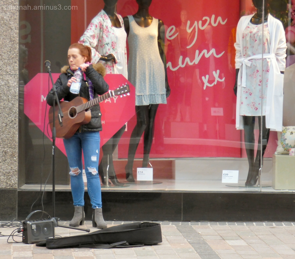 Busker outside Marks & Spencer, Stirling