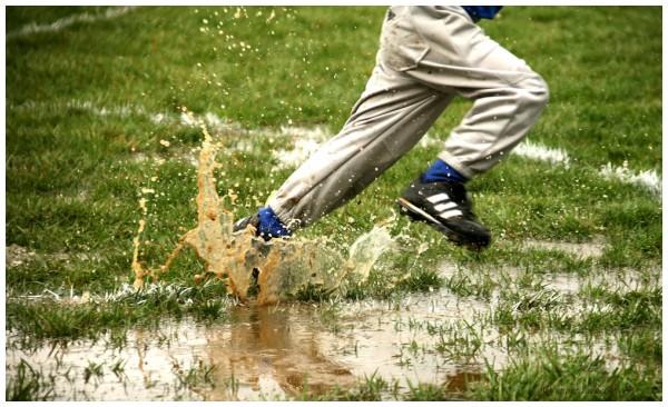 tee ball baseball muddy field puddle foot splash