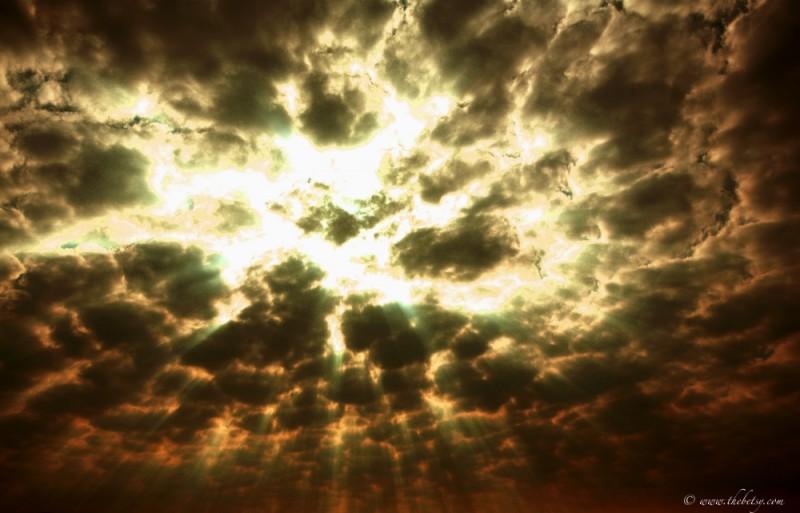 clouds sky rays sun striking breaking open