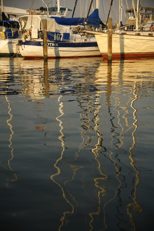 sunset boats reflections mast harbor rock hall