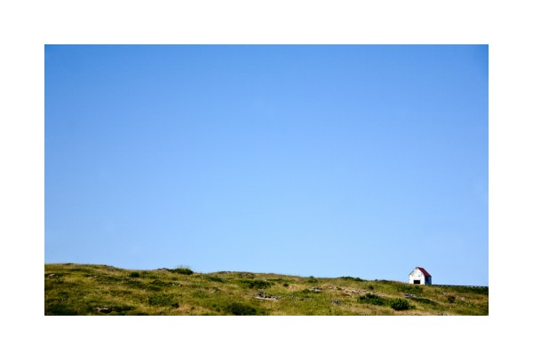 monhegan island red roof house skyscape negative s