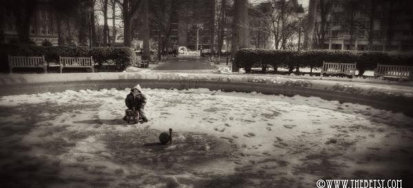 fountain winter child snow city alone