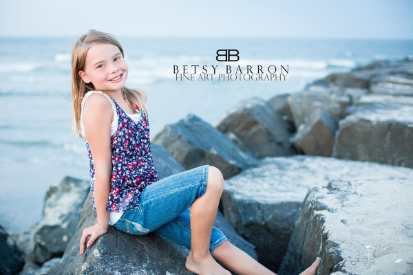 reese, daughter, girl,beach, jetty, rocks, sand,
