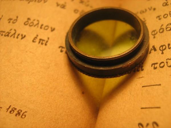 lens glass green book reflection heart