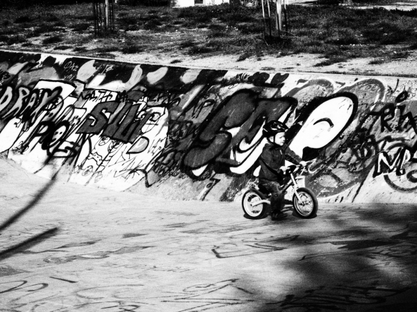 child cycling park graffiti
