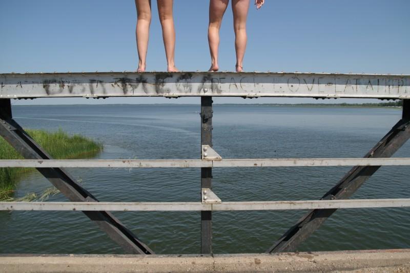 Sarah Guck girls jump from bridge Dredger