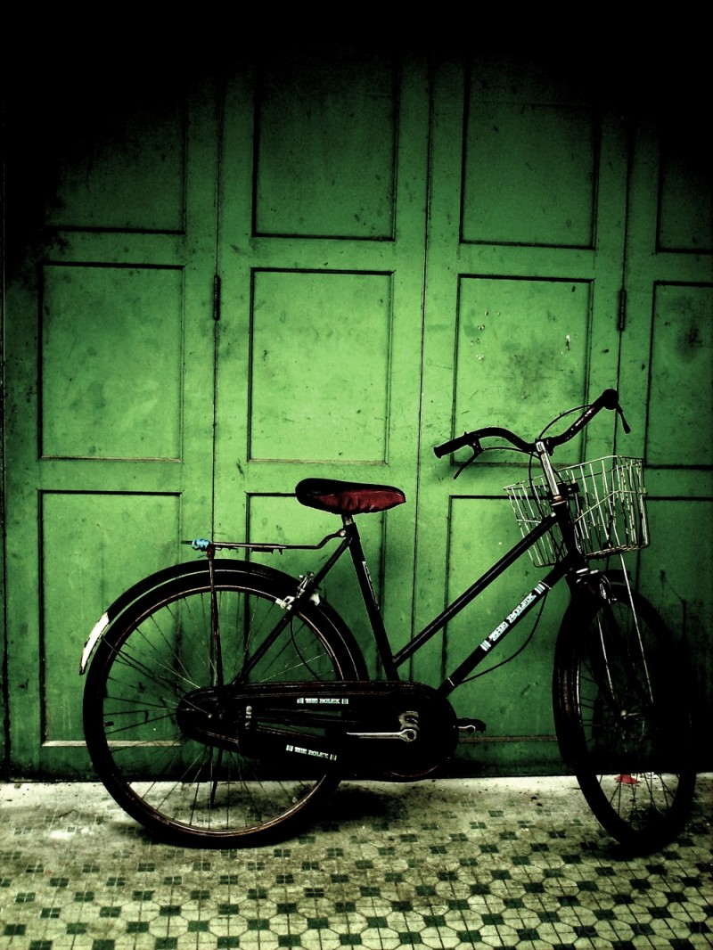 bike by a green wall
