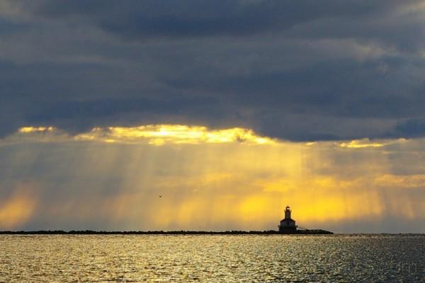 lighthouse storm clouds sunset