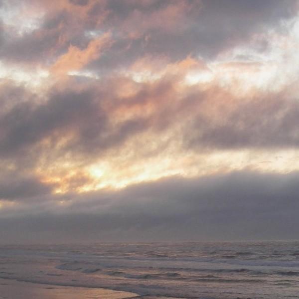 sunset storm clouds beach