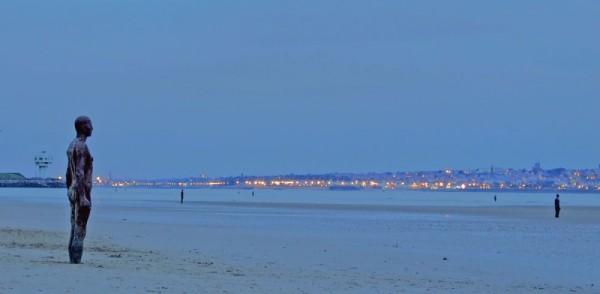 photo of antony gormley statues on crosby beach at