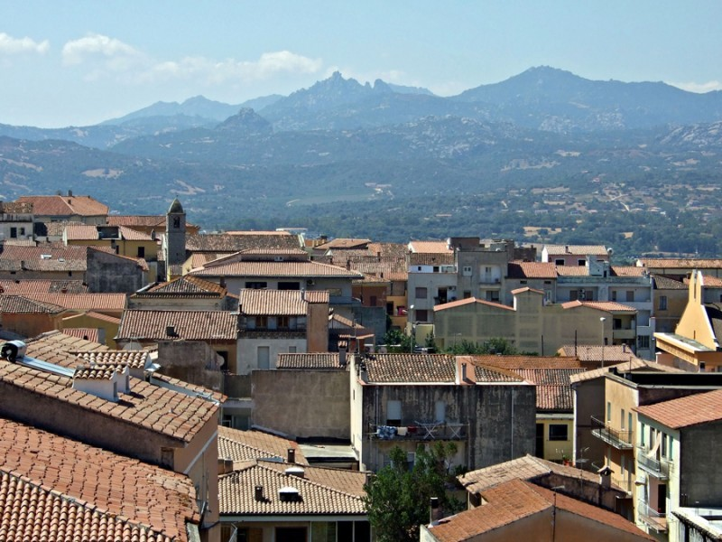 sardinia town with mountains in background
