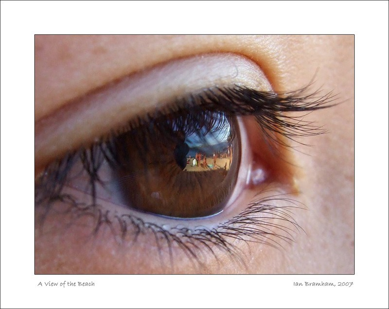 photo of an eye with beach reflections