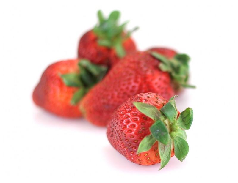 Fresh strawberries on white background.