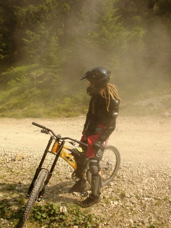 a photo of a downhill biker left in the dust