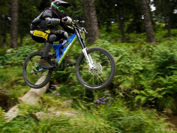 downhill jumping rider at poiana brasov