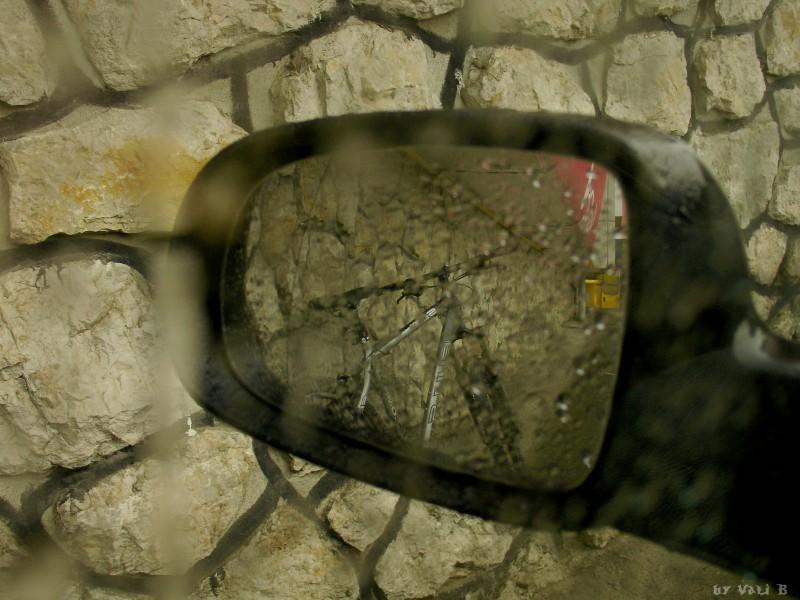 my bike reflecting in a car's mirror