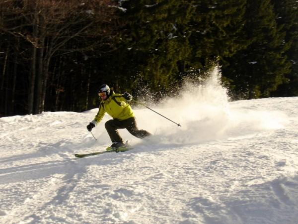 hard turn on a ski slope making snow powder