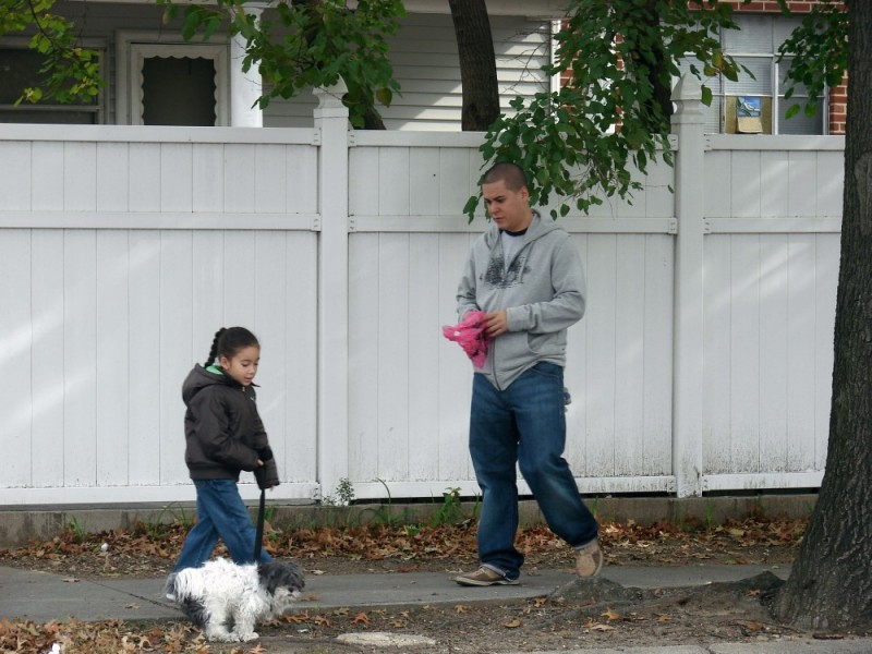 little girl learning how to walk the dog..