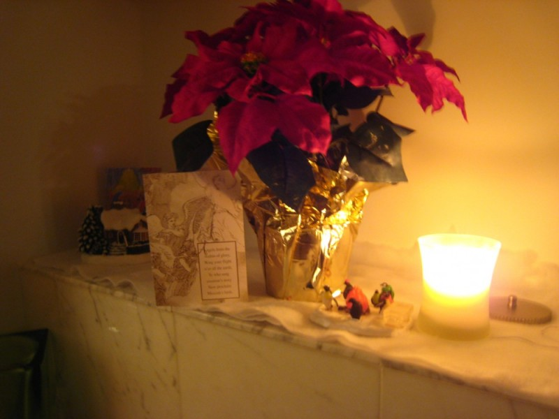 poinsetta with candle and card setting