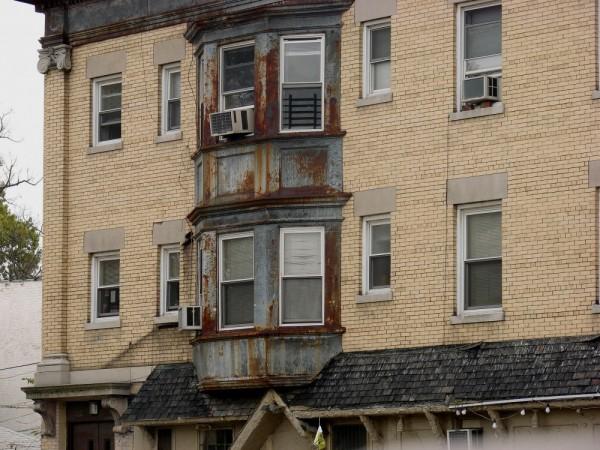 A rusty iron framed window