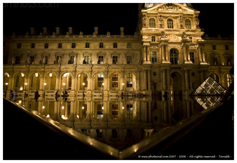 Night water reflection in the Louvre