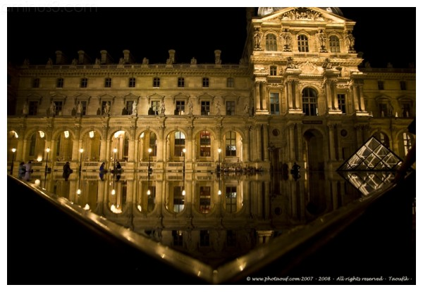 Night water reflection in the Louvre's courtyard