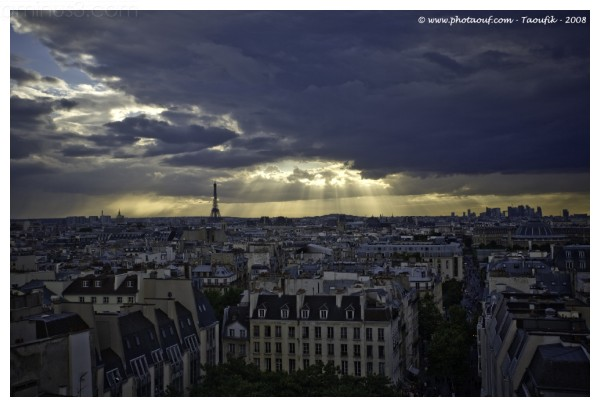 A view of Paris' roofs with the sun lights through