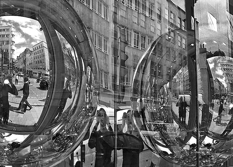 mirrored globes in shop window