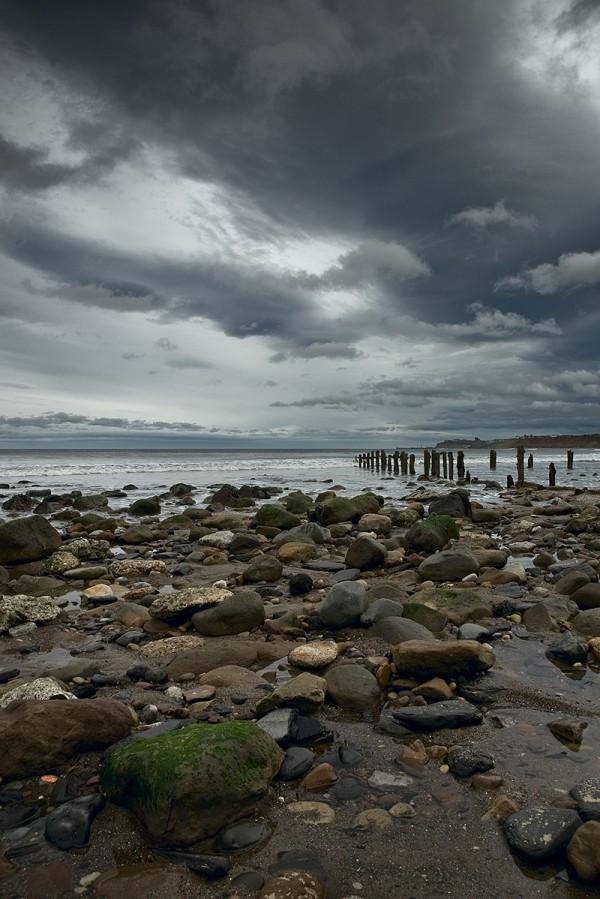 waves beach sea rocks pebbles sandsend