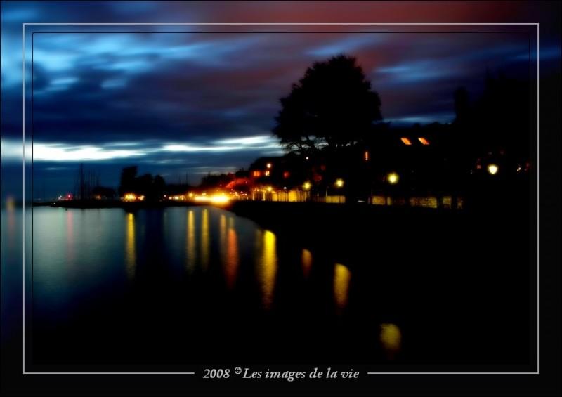 Beginning at night on the wharf Lutry. Lake Geneva