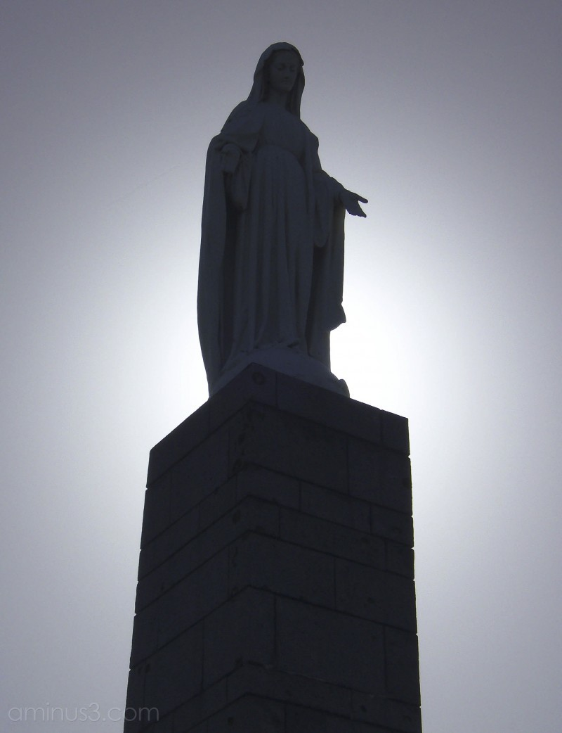 Statue of the Virgin watching over fallen soldier