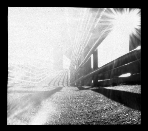 b&w pinhole bridge sunlight