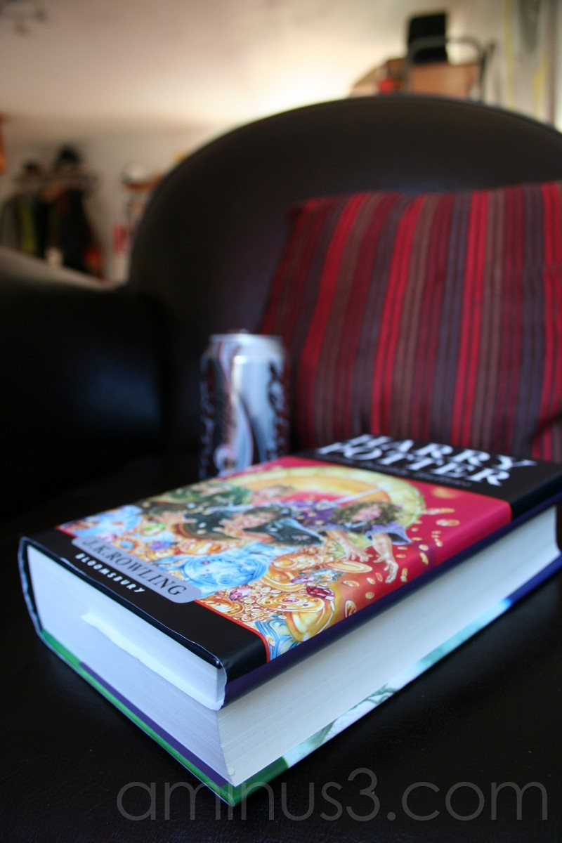 A book of Harry Potter on a leather armchair