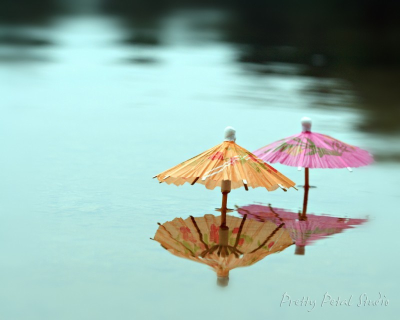 Cocktail umbrellas in a lake