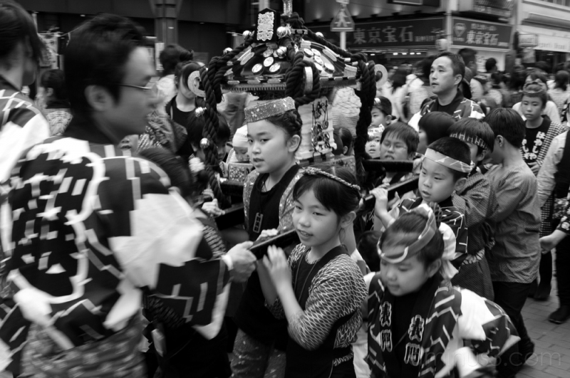 kids pulling a mikoshi in asakusa