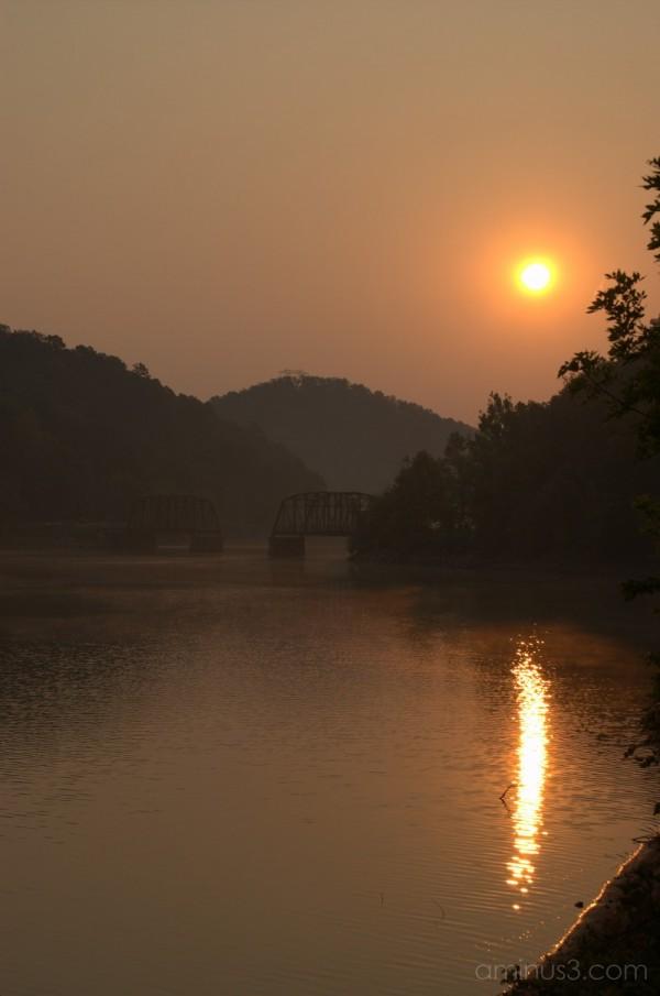 Sunrise Over the Broken Bridges