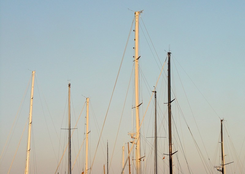 Masts of ships in the harbour of Mallorca.