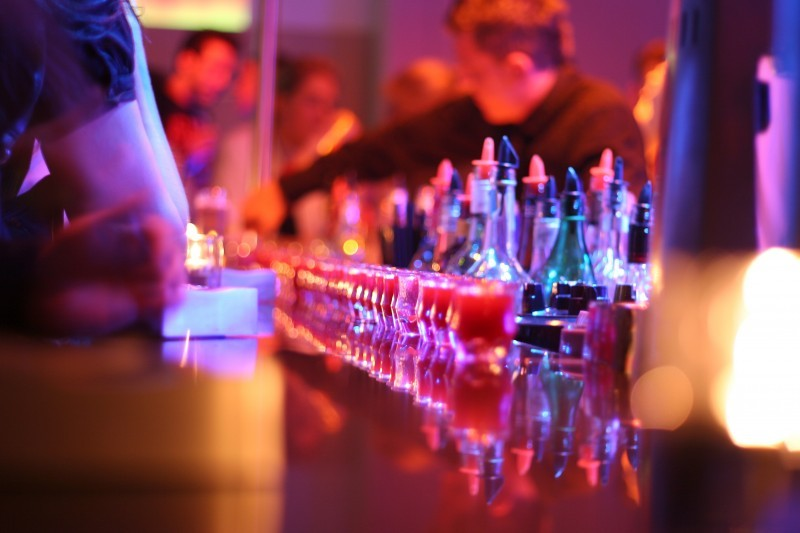 At the bar.