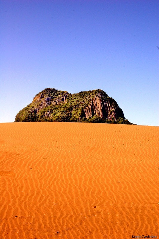 A mountain behind the dunes