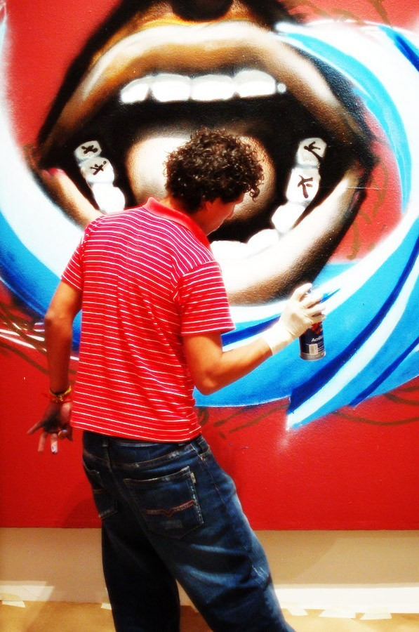 guy doing a graffiti