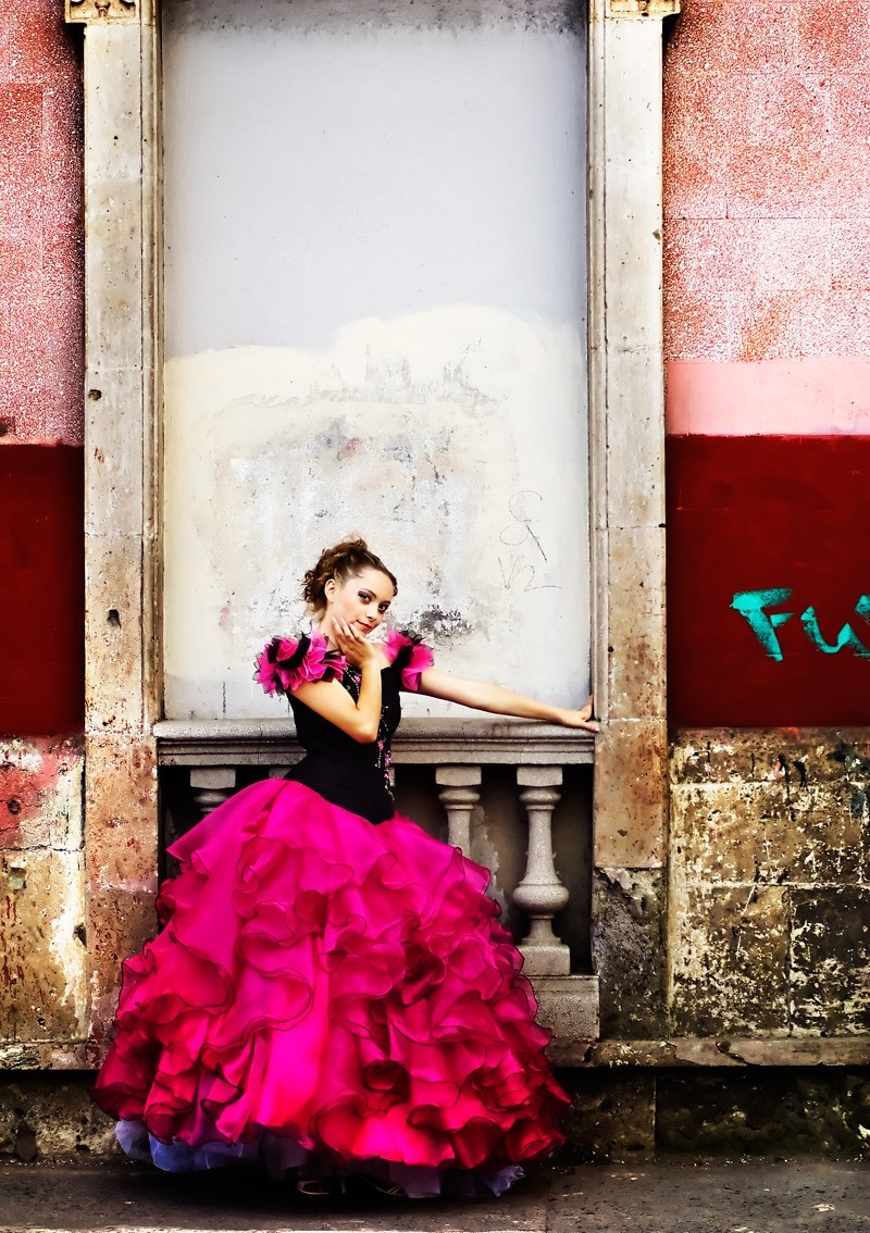 A girl with a pink and black dress