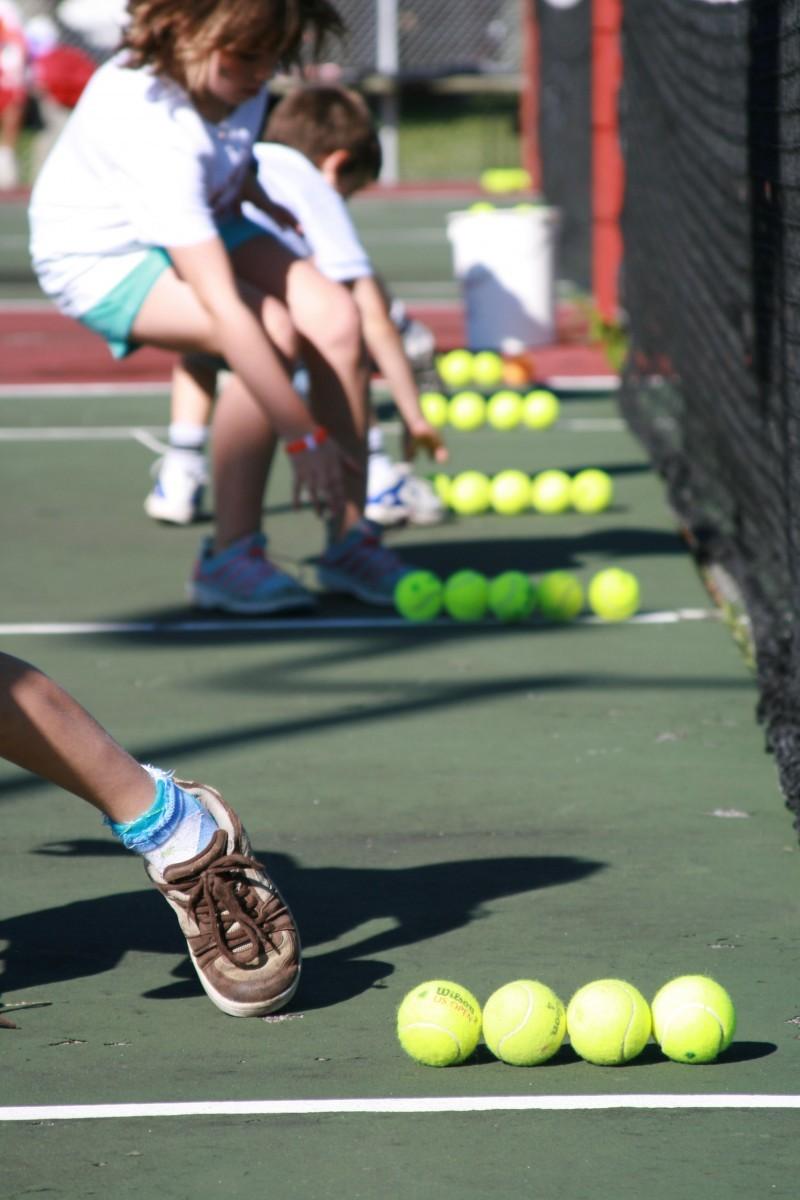 Kids during a tennis drill