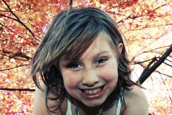 daughter under maple tree