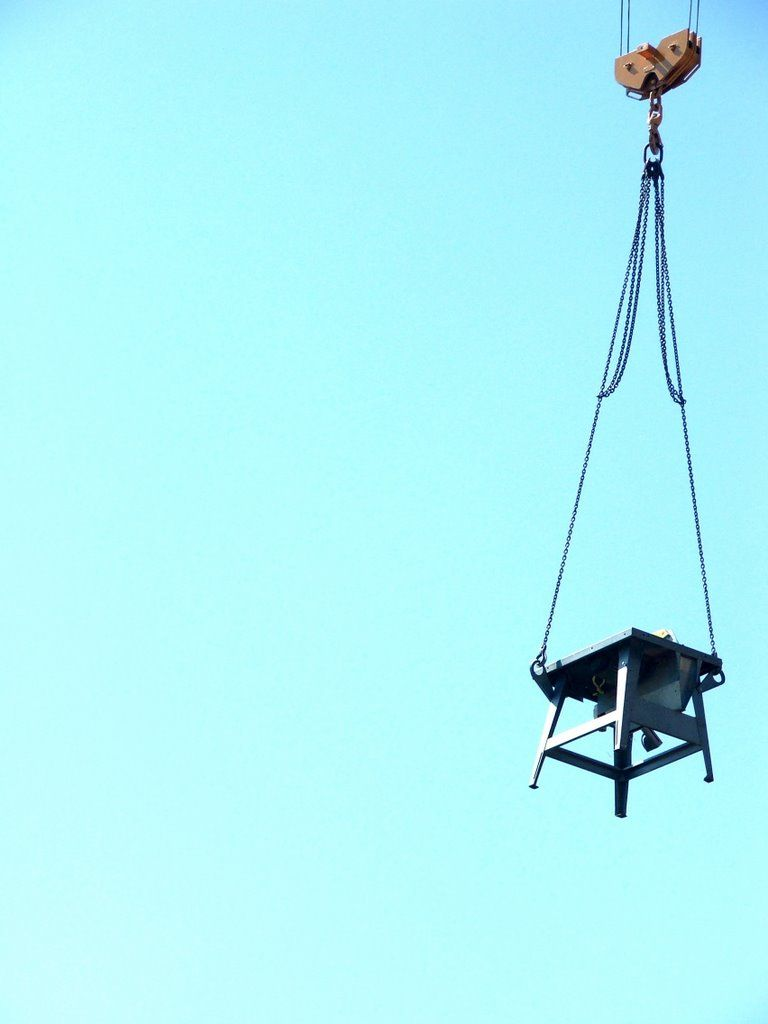 Table hanging on a crane