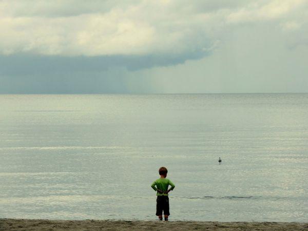 Little boy at a beach on Ruegen island