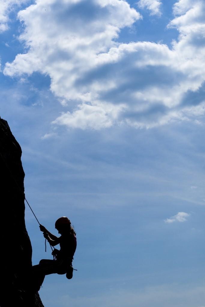 Girl climbing in backlight