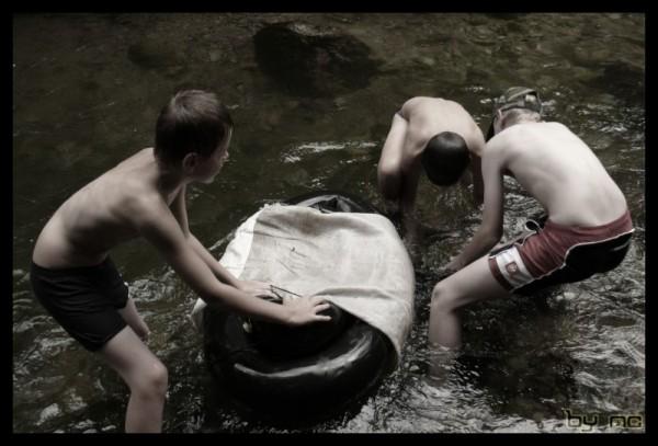 Watermen boys in the water