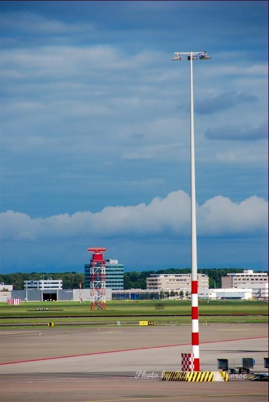 Lamp post airfield amsterdam cloud sky